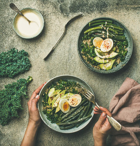 Quinoa kale beans avocado egg with creamy tahini dressing bowls