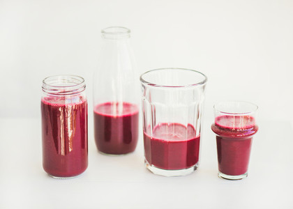 Fresh morning beetroot smoothie or juice in glasses white background
