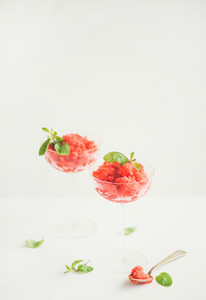 Strawberry and champaigne summer granita with mint in champagne glasses