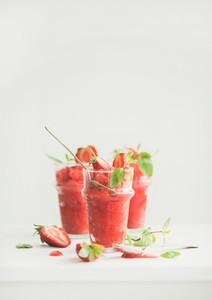 Strawberry and champaigne summer granita in glasses copy space