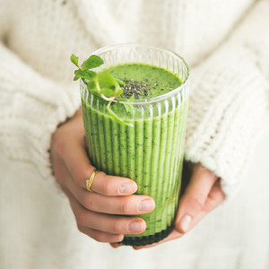 Matcha green smoothie with chia seeds and mint square crop