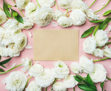 Flat lay of roses over light pink background  copy space