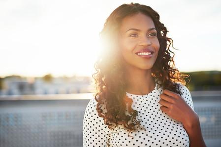 Attractive sunlit woman