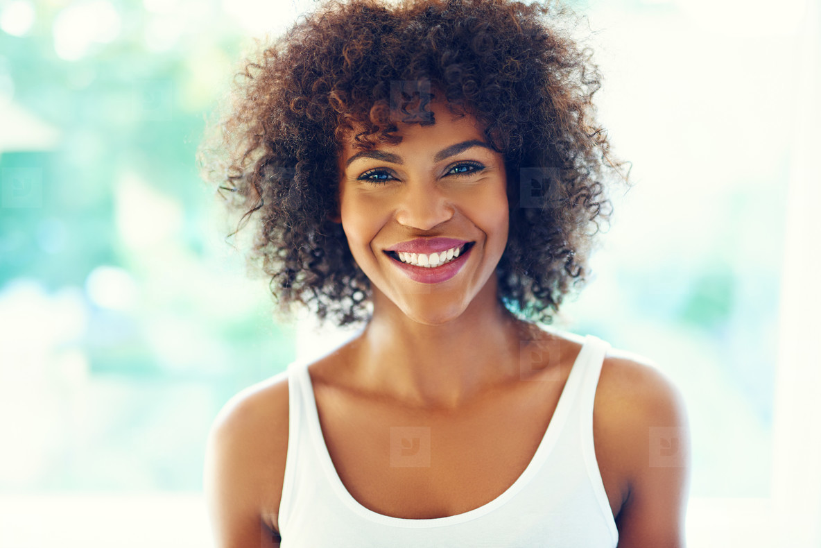 Happy curly woman
