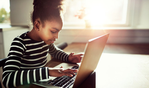 Pretty Black Girl Typing on Keyboard of her Laptop