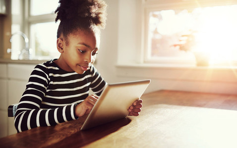 Young black girl browsing on a tablet pc