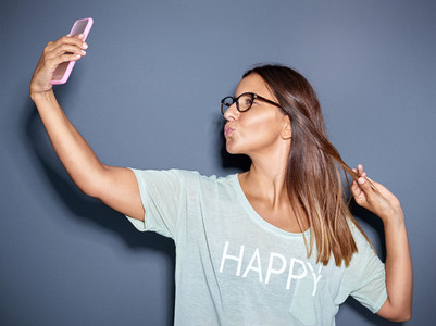 Young woman posing for a funny selfie