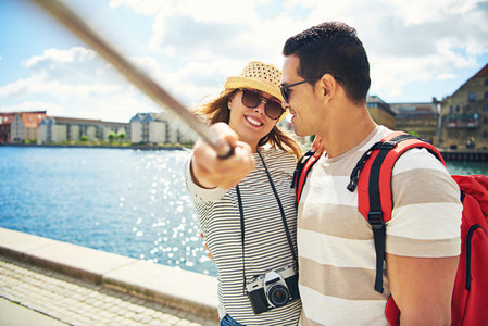 Happy backpackers taking a selfie on holiday