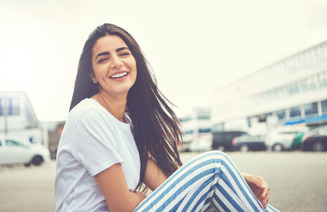 Smiling woman with striped pants turns to camera