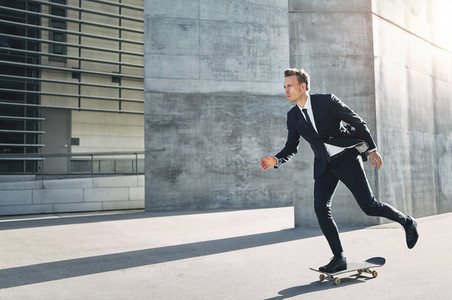 Skater wearing suit taking a ride in street
