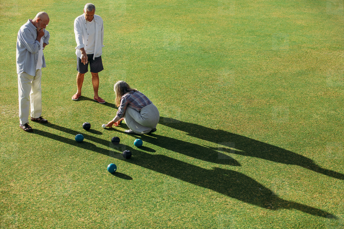 High angle shot of senior persons playing boules