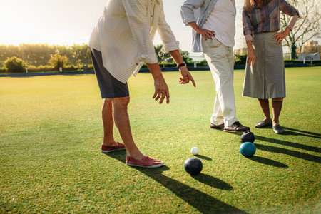 Group of people playing boules in a lawn