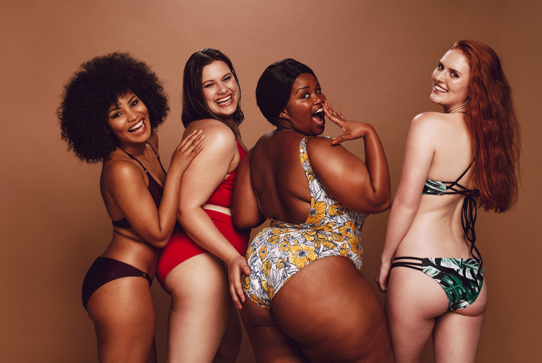 Group of different size women in bikinis
