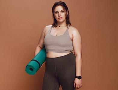 Oversized female with yoga mat