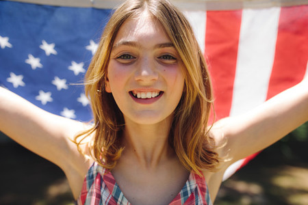 Portrait of a girl holding american flag