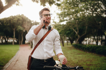Businessman talking on mobile phone standing in street
