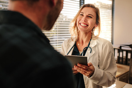 Friendly doctor interacting with her patient