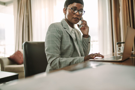 Businesswoman doing working from hotel room