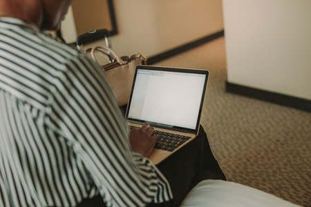 Female executive working from hotel room