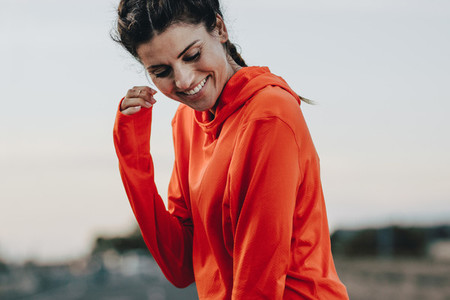Smiling sportswoman in tracksuit
