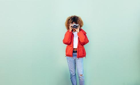 Woman taking a photo using a camera