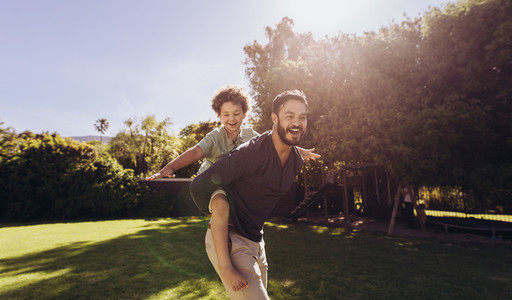 Father and son having fun playing in the park