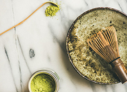 Japanese tools and bowls for brewing matcha tea  horizontal composition