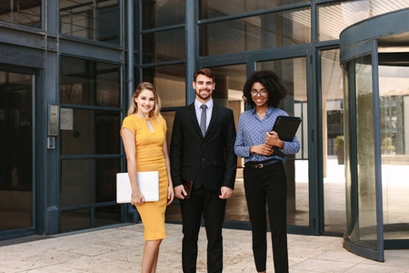 Businessman with female colleagues in corporate office building