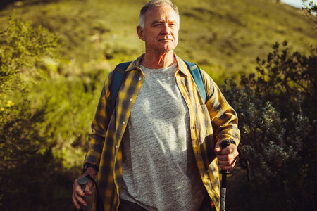 Portrait of a man hiking on a hill