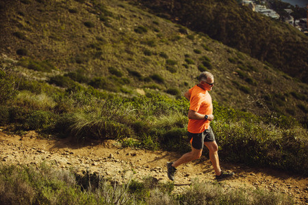 Senior man trail running