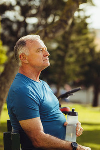 Portrait of a senior fitness person relaxing