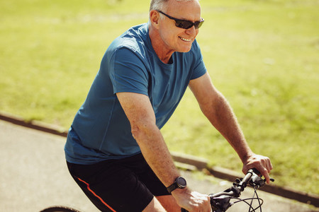 Senior man riding a bicycle for fitness