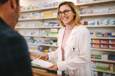 Helpful pharmacist dealing with a customer