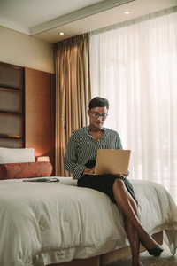 Business woman working from hotel room