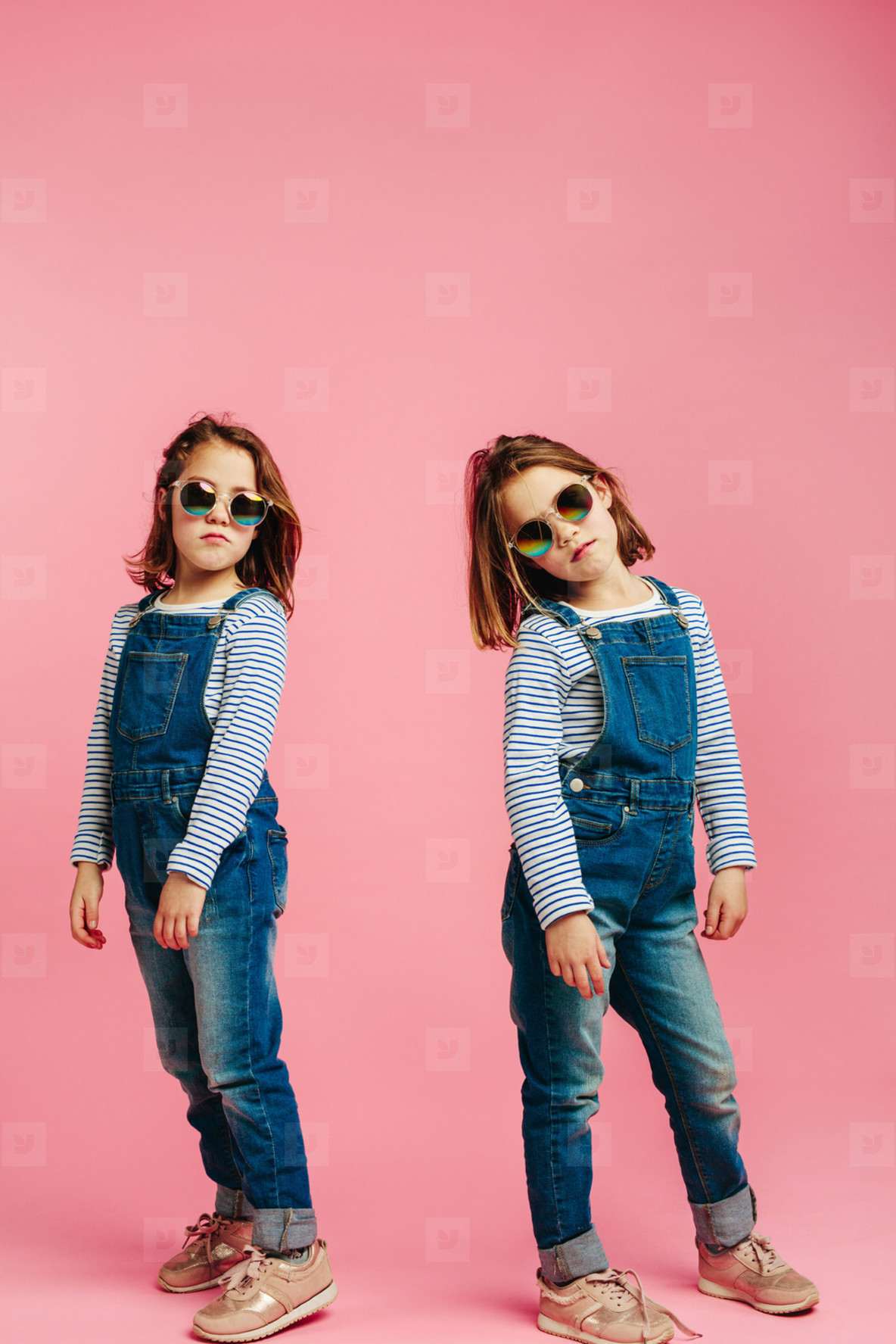 Stylish girls in denim dungarees
