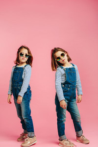 Stylish girls in denim dungarees