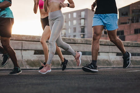 Group of runners workout together