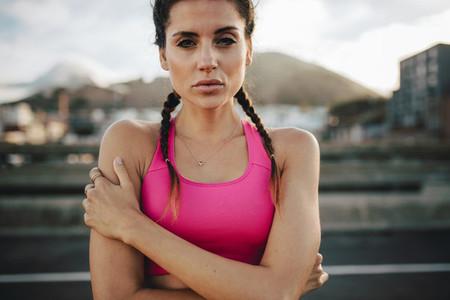 Fit female runner outdoors in morning