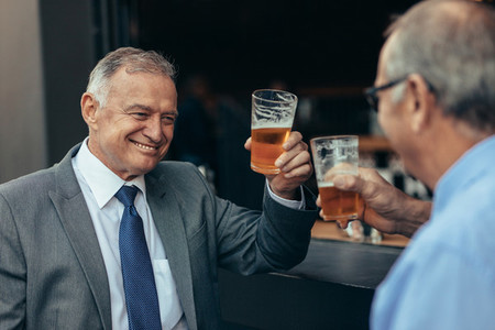 Businessmen having drinks after work
