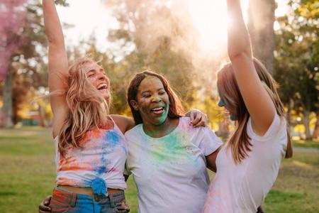 Friends enjoying holi outdoors having fun