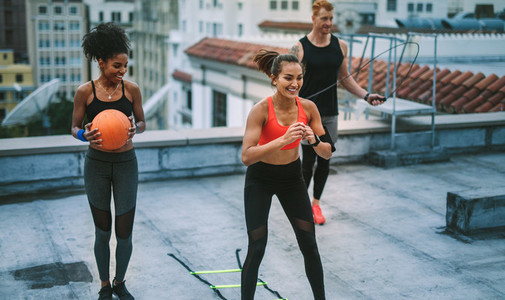 Fitness people doing workout on rooftop