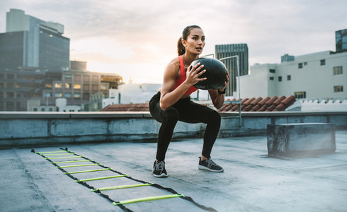 Fitness woman doing exercises on rooftop