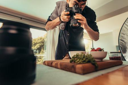 Professional food photographer in studio