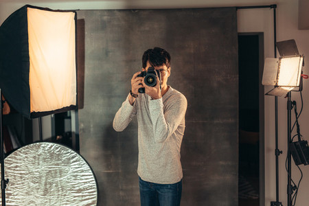 Professional photographer taking pictures in studio