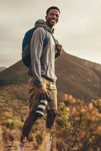Photographer on hike for social media content