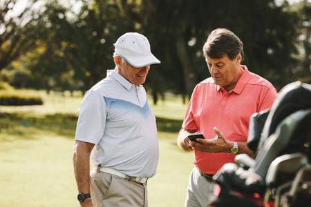 Senior man taking break from golfing
