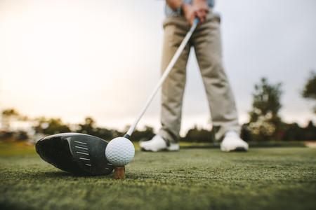 Golf club and golf ball on tee