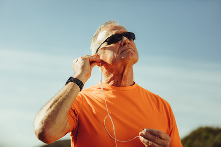 Close up of a senior man listening to music