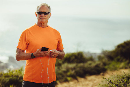 Portrait of a fitness person standing outdoors