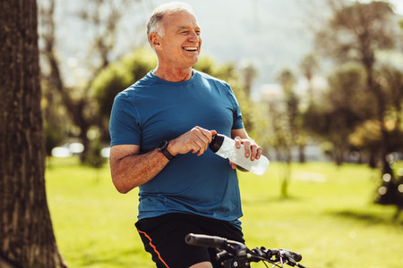 Senior fitness man drinking water
